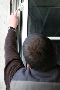 Man fitting a window